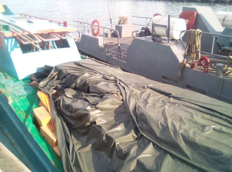 ZAMBOANGA. Personnel of the Naval Forces Western Mindanao intercepted early Thursday, June 20, M/B Farniza which is loaded with some P22.5 million worth of smuggled cigarettes off Zamboanga City. (Contributed photo)