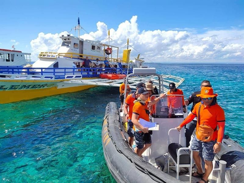 ON PATROL. Officers of the Philippine Coast Guard  (PCG) lead the  patrol on the waters off Mactan Island on Thursday, June 20, 2019, to check the motorboats' compliance with safety standards. (Contributed photo / PCG 7)