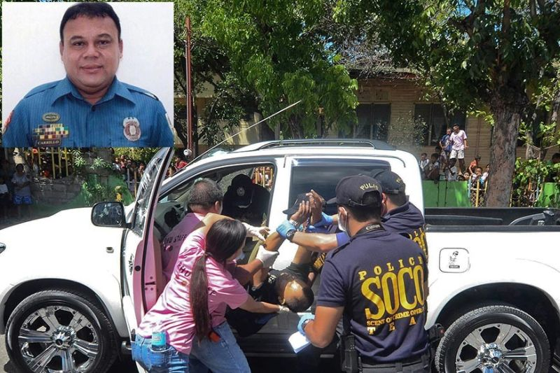 ANOTHER POLICEMAN KILLED: Chief MSgt. Deogenes Carrillo, deputy chief of the Cordova Police Station, is pulled out from the driver's side of the pickup after two men in a motorcycle fatally shot him in Poblacion, Cordova past 10 a.m. Thursday, June 20, 2019. Carrillo (inset) was into money lending. (Photo by Alan Tangcawan)