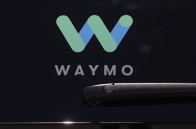 LAUNCH. Self-driving car pioneer Waymo is teaming up with automakers Renault and Nissan to make its first journey outside the United States with a ride-hailing service that will dispatch a fleet of robotaxis in France and Japan. This photo, taken on May 8, 2018, shows a Waymo logo displayed on the window of a car at the Google I/O conference in Mountain View, California. (AP Photo)