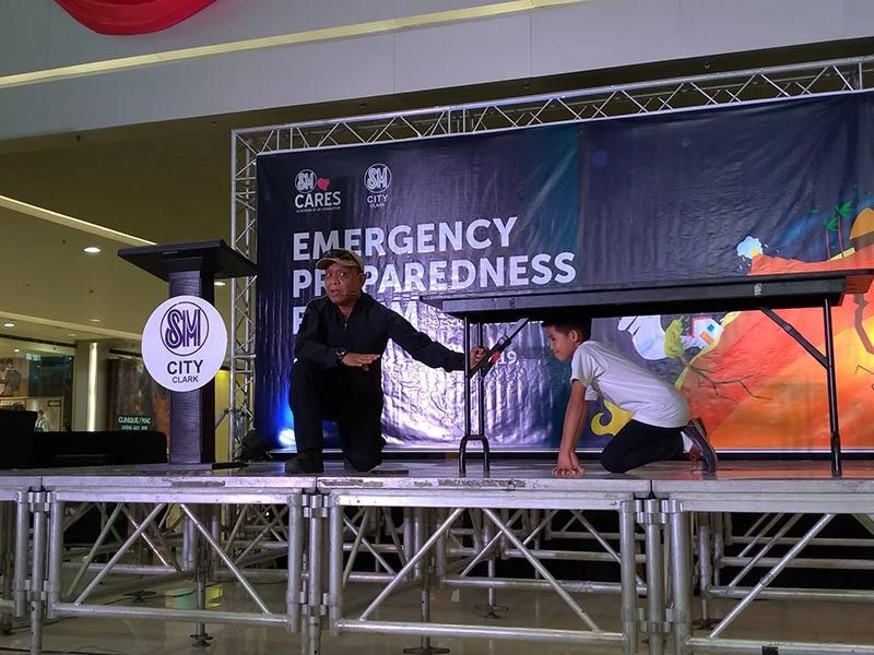 PAMPANGA. Dr. Ted Esguerra teaches a student with disability how to respond during an earthquake. (Contributed Photo)