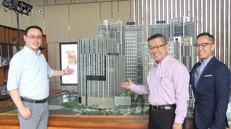 NEW OFFICE ADDRESs. From left, Mandani Bay project director Gilbert Ang, project adviser Jeffrey Lun and sales head Audrey Villa showcase the scale model design of One Mandani, the first office tower to erect in Mandani Bay. (SunStar Photo/Amper Campaña)