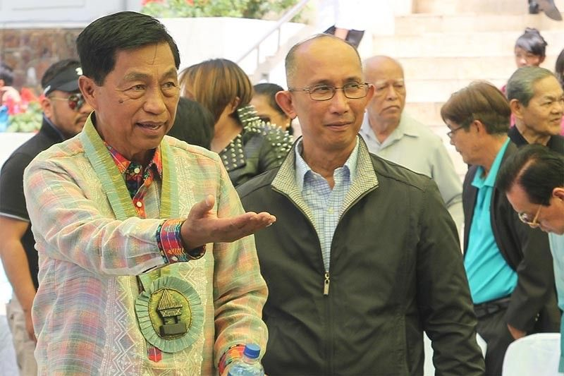 BAGUIO. Outgoing Baguio City Mayor Mauricio Domogan and incoming Mayor Benjamin Magalong join the flag raising ceremony at the Baguio City Hall. Magalong clarified once he assumes, his management style at City Hall will not mirror his military background. (Jean Nicole Cortes)