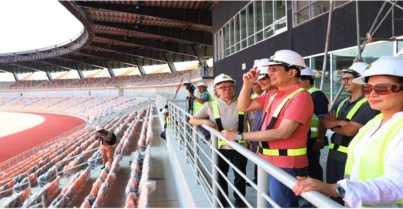 Senators Panfilo Lacson and Gregorio   Honasan II visit the world-class Athletic Stadium in   New Clark City. The 20-000 seater stadium will be used   during the Philippines' hosting of the South East Asian   Games this year. With them are officials of the Bases   Conversion and Development Authority led by president   Vince Dizon and infrastructure developer MTD   Philippines. (BCDA photo)