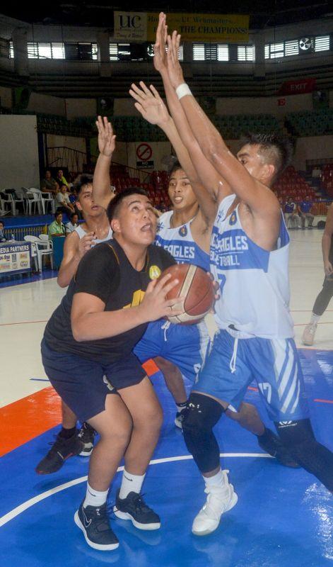 TRAPPED. A lone University of Southern Philippines-Foundation player finds himself against three defenders from SHS-Ateneo de Cebu during their Partners Cup game. (SUNSTAR FOTO / ARNI ACLAO)