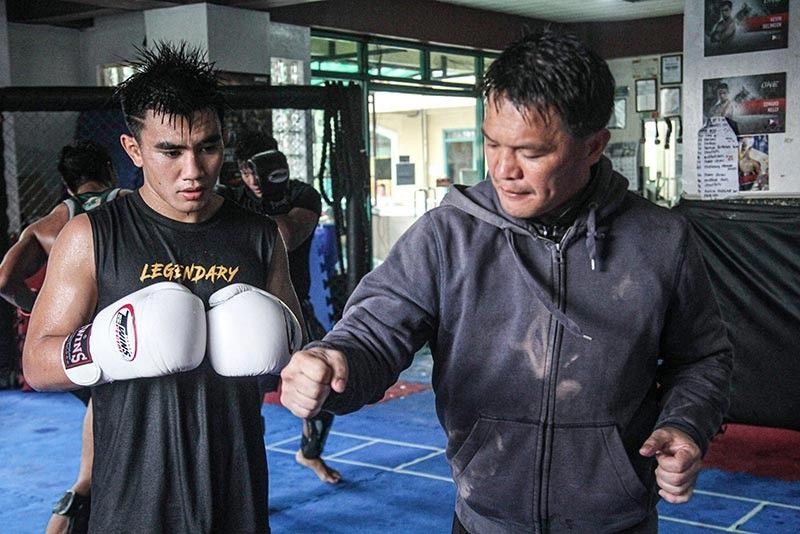 BAGUIO. Coach Mark Sangiao gives some pointers to ONE strawweight world champion Joshua Pacio. Sangiao is also training Eduard Folayang, Danny Kingad and Honorio Banario for ONE's Dawn of Heroes on August 2 at the Mall of Asia Arena. (Jean Nicole Cortes)