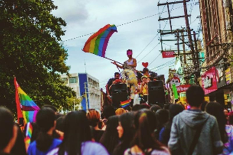 BACOLOD. A man waving around the town plaza a rainbow flag which is the LGBTQ  symbol. (Nichol Francis Anduyan)
