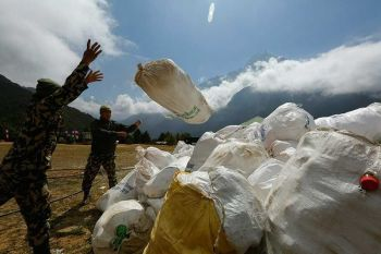 NEPAL. In this May 27, 2019 photo, Nepalese army men pile up the garbage collected from Mount Everest in Namche Bajar, Solukhumbu district, Nepal. The record number of climbers on Mount Everest this season has left a cleanup crew grappling with how to clear away everything from abandoned tents to human waste that threatens drinking water. (AP)