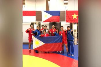 DAVAO. The Pilipinas Sambo team coaches, players and officials pose after collecting a total of two gold medals, two silvers and one bronze in the 2nd Southeast Asia Sambo Championships held recently in Indonesia. (Photo from Paolo Lim Tancontian Facebook account)