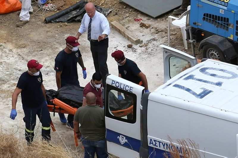 CYPRUS. In this photo taken on Tuesday, June 4, 2019, Cyprus' Special Disaster Response Unit investigators carry a covered suitcase on a stretcher after it was retrieved from a man-made lake near the village of Mitsero, outside of the capital Nicosia, Cyprus. (AP)
