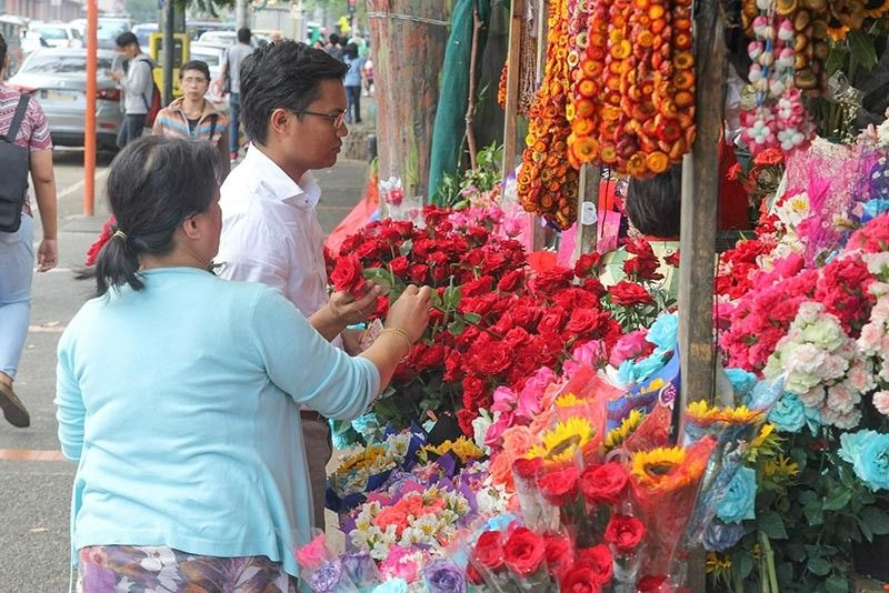 BAGUIO. Flower shops thrive along Harrison Road in Baguio City as vendors enjoy brisk sales even during lean months such as the rainy season. (Photo by Jean Nicole Cortes)