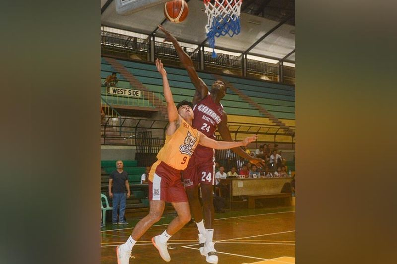 SOLID DEFENSE. SWU's import Lamine Thiam (right) defends the basket during the 2019 Cesafi Partners Cup. He will lead SWU in the Bayugan City Invitational Tournament. (SunStar photo / Arni Aclao)