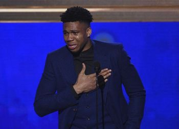 NBA player Giannis Antetokounmpo, of the Milwaukee Bucks, reacts as he accepts the most valuable player award at the NBA Awards on Monday, June 24, 2019, at the Barker Hangar in Santa Monica, Calif. (AP Photo)