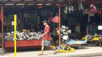 CAGAYAN DE ORO. A man passes by a pile of imported hand-me-down shoes and clothes commonly referred to Filipinos as