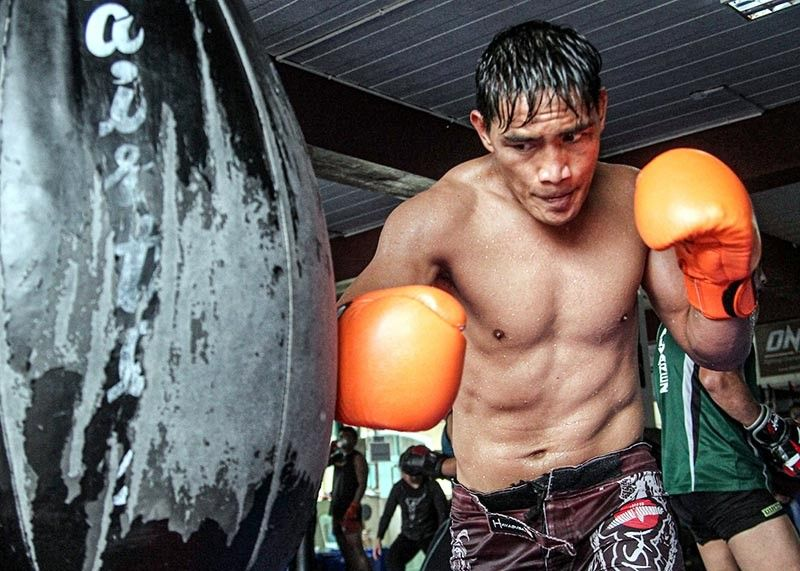 BAGUIO. Eduard Folayang trains with the heavy bag as he gears up against Eddie Alvarez on August 2 at the Mall of Asia Arena. (Photo by Jean Nicole Cortes)