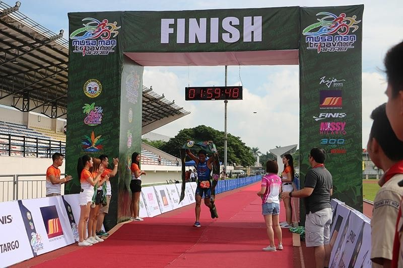 I AM THE CHAMPION. Jorry Ycong of Rider Omega Pro Team celebrates at the finish line for winning the 3rd Musa Man Tri-DavNor held recently from Hijo Resorts to Davao del Norte Sports and Tourism Complex in Tagum City. (Contributed photo)