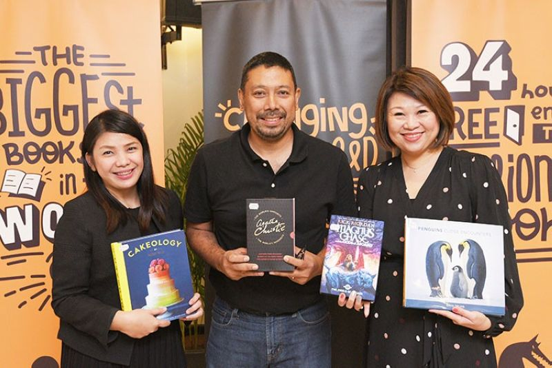 PAMPANGA. Narisa dela Pena, Big Bad Wolf Books country manager; Luis Oquinena, Gawad Kalinga executive director; and Jacqueline Ng, Big Bad Wolf Books co-founder, with books in hand, pose for a photo opportunity during the press conference held at the Microtel San Fernando. (Contributed photo)