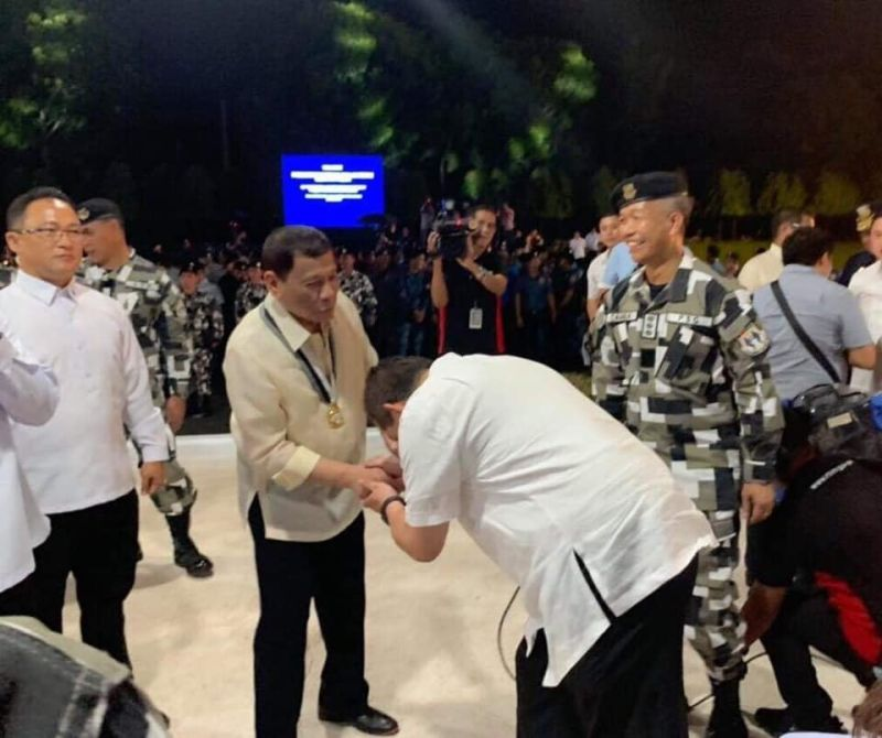 MANILA. Returning congressman Ferdinand Martin Romualdez bows as he shakes hands with President Rodrigo Duterte during the 122nd anniversary celebration of the Presidential Security Group on June 26, 2019. (From Martin Romualdez Facebook)