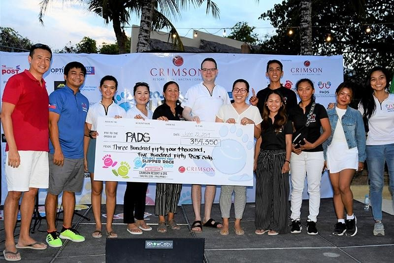 GIFT OF RACE. The management of Crimson Resort and Spa Mactan turns over the amount raised by its race to the representatives of  the Philippine Accessible Disability Services, which has a program for deaf women and children. (Contributed photo)