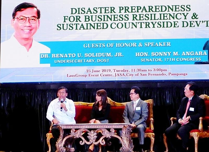 PAMPANGA. Science and Technology Undersecretary Renato Solidum Jr. talks about the importance of disaster preparedness as the key to business resiliency during PamCham's 63rd GMM at the LausGroup Event Centre. Listening are Sen. Sonny Angara's chief of staff Fatima Lipp Panontongan, PamCham president Rene Romero and PamCham chairman Jess Nicdao. - JTD