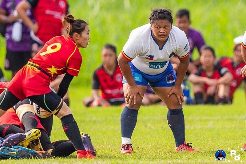 LAGUNA. Nova Belle Tega, right, marks her Philippine Lady Volcanoes debut with a silver medal finish in the Rugby Asia Women's Championship Division 1 held recently at Southern Plains, Canlubang in Laguna. (Raymond Braganza)