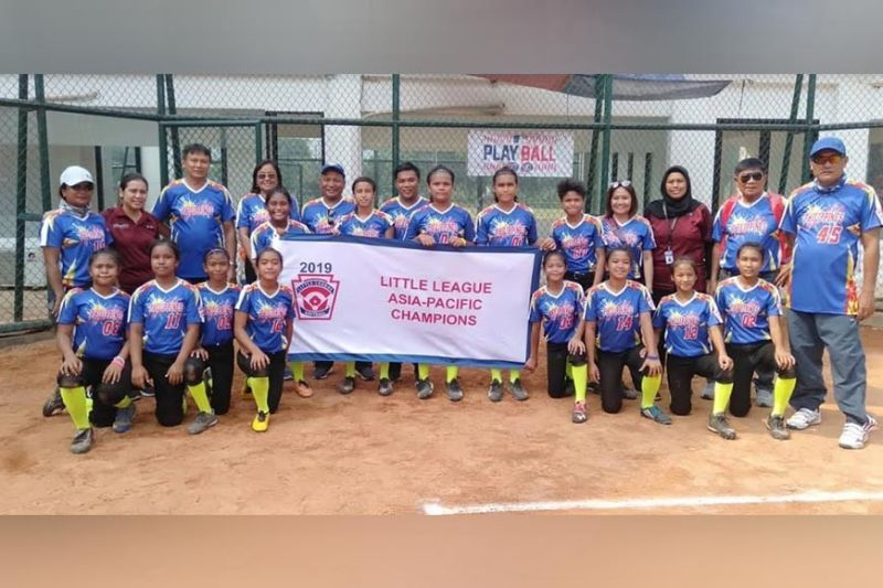The Little League Philippine team, composed of 13 ETCS-I pupils, was declared the Asia Pacific Regional champion Saturday in Indonesia. They will represent the region to the2019 Little League Softball World Series championship in Portland, Oregon in August. Joining them in this photo are their coaches. (Contributed photo)
