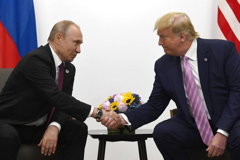 OSAKA, JAPAN. President Donald Trump, right, shakes hands with Russian President Vladimir Putin during a bilateral meeting on the sidelines of the G-20 summit in Osaka, Japan, Friday, June 28, 2019. (AP Photo/Susan Walsh)
