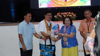 Department of Agriculture (DA)-Davao Region OIC-director Engr. Ricardo Oñate, Jr. (2nd from left) receives a token of appreciation from the provincial government. (Contributed photo)