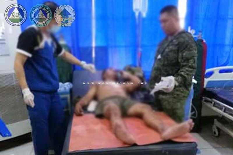 SULU. An army trooper is being treated in a hospital after the suicide bombing incident at the headquarters of the First Brigade Combat Team in Tanjung, Indanan, Sulu at 12 noon Friday, June 28. Three soldiers died and nine others were wounded. (Westmincom photo)