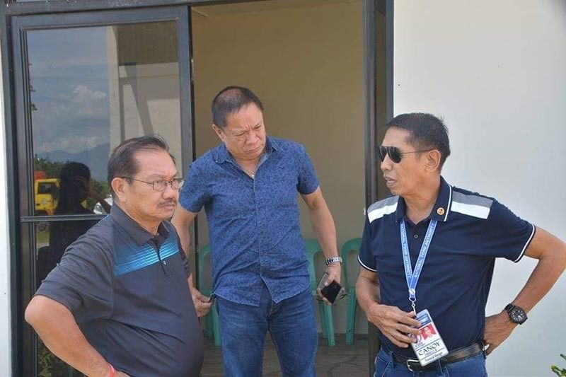 NEGROS. Agriculture Secretary Emmanuel Piñol (left) with Provincial Agriculturist Japhet Masculino (center) and NFA-Negros Occidental Provincial Manager Frisco Canoy (right) during his visit at the Rice Processing Complex in Barangay Tabunan, Bago City last year. (File photo)