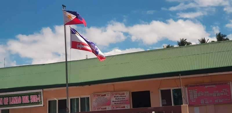 CAGAYAN DE ORO. In a public elementary school in Saguiaran, Lanao del Sur, a new Bangsamoro flag flies beneath the Philippine flag. There have been no reports yet on whether there is already an official flag for the new Bangsamoro Autonomous Region for Muslim Mindanao. (SunStar Cagayan de Oro file photo)
