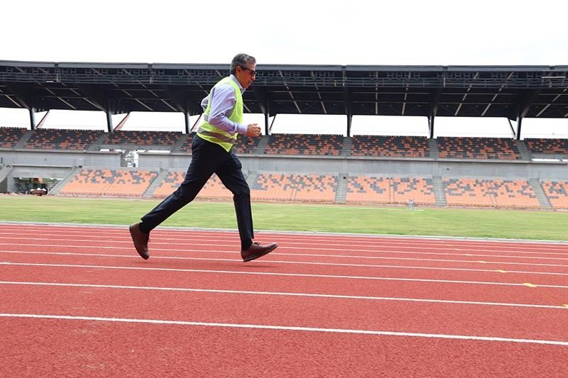 FIRST TRY. Citi Country Officer Aftab Ahmed tries the newly-built track at the world-class Athletic Stadium. (CDC Photo)