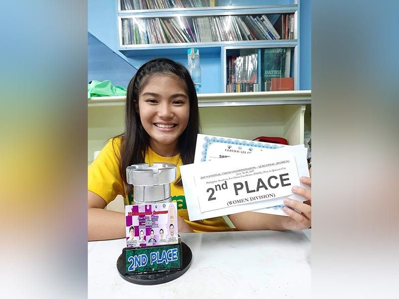 BATANGAS. Samantha Umayan, a 12-year-old player from Davao City, beams with pride as she places second in women's division of the 2019 National Chess Championships semi-final round held recently in Malvar, Batangas. (Photo by Melinda Umayan)