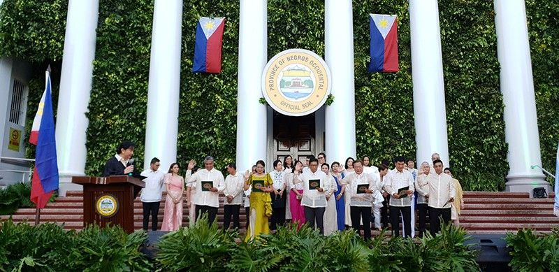 BACOLOD. Members of the Sangguniang Panlalawigan in the Norther Negros Occidental took their oath of office. (Contributed photo) 8. BACOLOD. Vice Governor Ferrer signs his appointment before former Governor Maranon. The new Vice Governor was joined by his family. (Contributed photo)