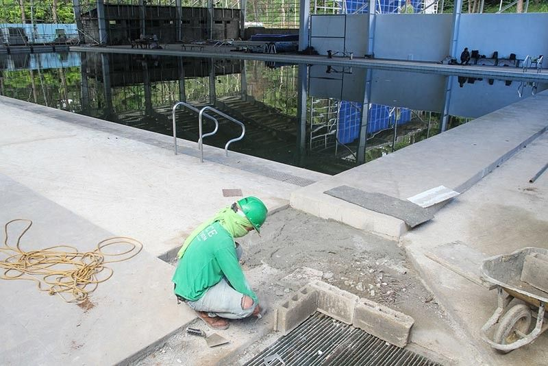 BAGUIO.A worker lays out improvement at the swimming pool of the Baguio Athletic Bowl. Gaudencio Gonzales of the Baguio City Sports Office on Wednesday revealed the civil and other works being implemented inside the pool worth P34 million will be completed by September. (Photo by Jean Nicole Cortes)