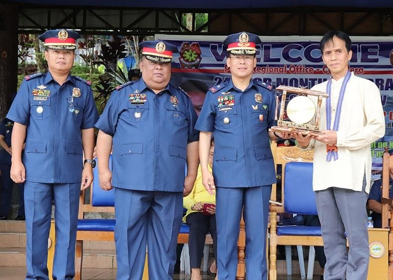 PCR MONTH. Police Regional Director Cordillera Director Israel Ephraim Dickson(3rd from left) hands over to Office of the Civil Defense Cordillera Deputy Director Edgardo Ollet a token from PROCOR during the observation of the Police Community Relations month at Camp Dangwa, La Trinidad, Benguet. With them are Police Colonel's Mafelino Bazar, Deputy Regional Director for Op)erations and Joseph Ulysses Gohel, Deputy Regional Director for Administration. (PRO – COR PIO photo)