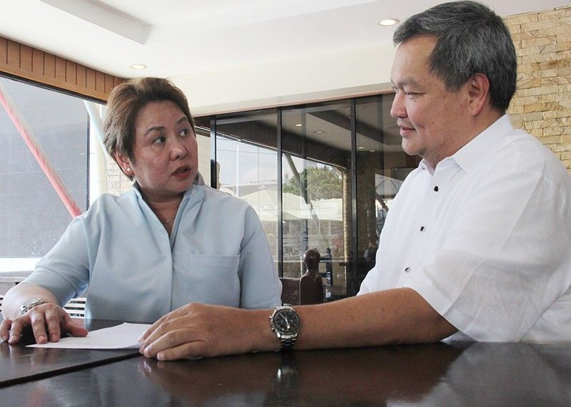 NON-EXISTENT. Customs Cebu head Elvira Cruz ( left ), with counsel Zeus Librojo, is fighting a transfer to what she says is a non-existent office. (SunStar Photo/Amper Campaña)