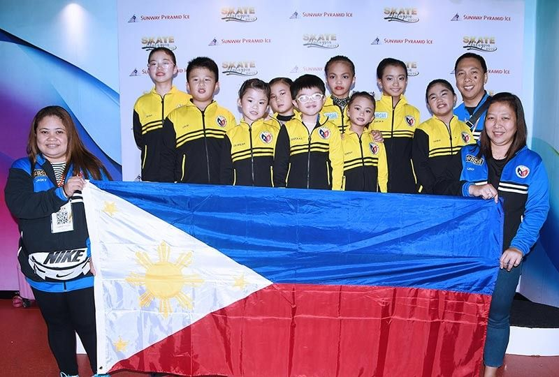 MALAYSIA SOJOURN. Cebu skaters (from left) Diana, David, Deandra, Dawn and Douglas Gothong and Maurelle Paredes, Erphy Claire MacKenzie, Francesca Claire Go and Rianna Millan won 38 gold medals in Malaysia. They were joined by coaches Jacky Bengil, Leny Gomez and Al Marinas. (Contributed photo)
