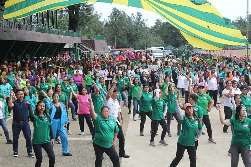 """BAGUIO. More than 400 people from various health agencies and advocates simultaneously dance zumba during the launching of the nutrition month at the Baguio Athletic Bowl on July 3. This year's nutrition month is themed """"Kumaain ng Wasto at Maging Aktibo Push Natin to"""". (Photo by Jean Nicole Cortes)"""