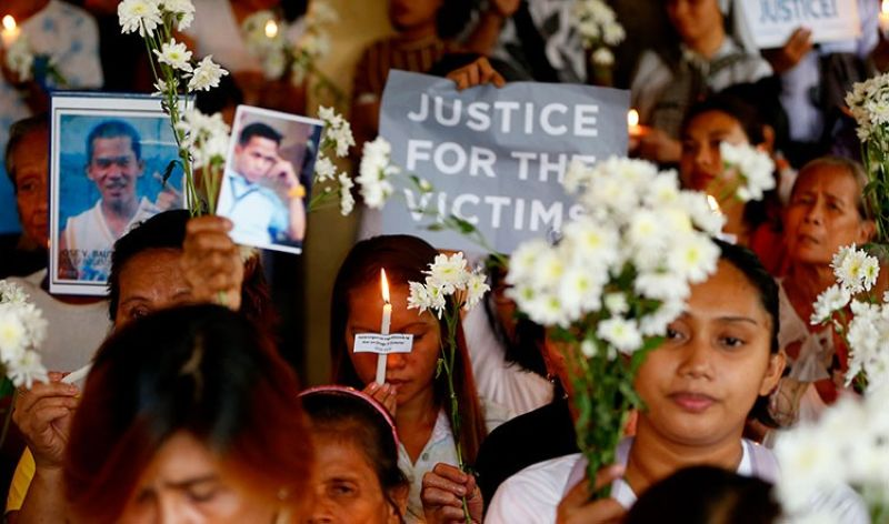 MANILA. In this March 17, 2019, file photo, relatives of victims in President Rodrigo Duterte's so-called war on drugs hold a memorial for their loved ones at a church in Manila. (AP)