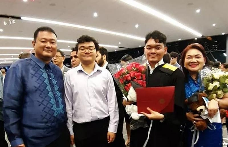 CANADA. Gerlino Dominic Furbeyre Tamayo (3rd from left) pose with his parents Eric Gerardo (1st from left) and Joyce and brother Jacques after the graduation rites. (Contributed photo)