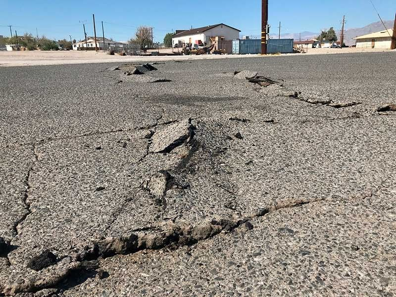 CALIFORNIA. A road is damaged from an earthquake on July 4, 2019 (California time) in Trona, Calif. A strong earthquake rattled a large swath of Southern California and parts of Nevada on Thursday, rattling nerves on the July 4th holiday and causing some damage in a town near the epicenter, followed by a swarm of aftershocks. (AP Photo)