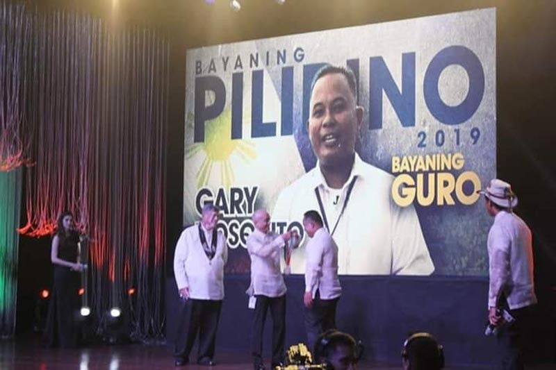 MANILA. Gary Mosquito, a teacher from Cabarasan Daku Elementary School in Palo, Leyte, receives his award as this year's national winner for Bayaning Gurong Pilipino during the 15th Gawad Geny Lopez Jr. Bayaning Pilipino Awards sponsored by ABS-CBN and Ugat Foundation in Manila July 3, 2019. (Contributed photo)