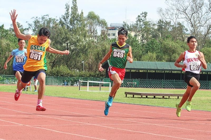 BAGUIO. Batang Pinoy athletes race against time at the Baguio Athletic Bowl during last year's Batang Pinoy National Championships hosted by the City of Pines. (Jean Nicole Cortes)