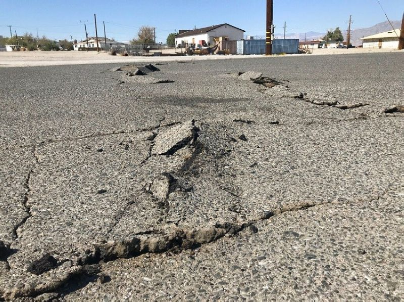 LOS ANGELES. A road is damaged from an earthquake Thursday, July 4, 2019, in Trona, Calif. A strong earthquake rattled a large swath of Southern California and parts of Nevada on Thursday, rattling nerves on the July 4th holiday and causing some damage in a town near the epicenter, followed by a swarm of aftershocks. (AP Photo/Matt Hartman)