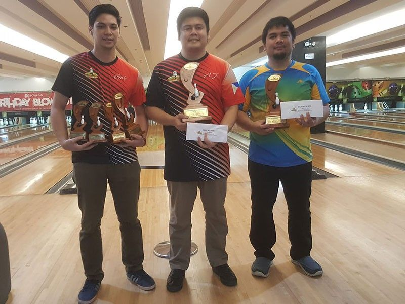 DAVAO. From left, third placer Gabriel Velasco, champion Arthur John Galendez and runner-up Jesrael Rule receive their trophies and prizes at the close of the Datba June monthly finals tournament held recently at SM Lanang Premier Bowling Center. (Jesrael Rule Facebook)