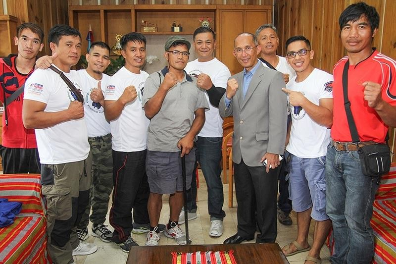 PAMPANGA. The Northern Luzon Kickboxing Alliance (NLKA) represented by 18 athletes and their coaches from seven gyms pay a courtesy call to Baguio City Mayor Benjamin Magalong on Thursday morning, July 4 before heading to Tagaytay to compete in the national kickboxing tryouts for the 2019 SEA Games in December. (Photo by Jean Nicole Cortes)