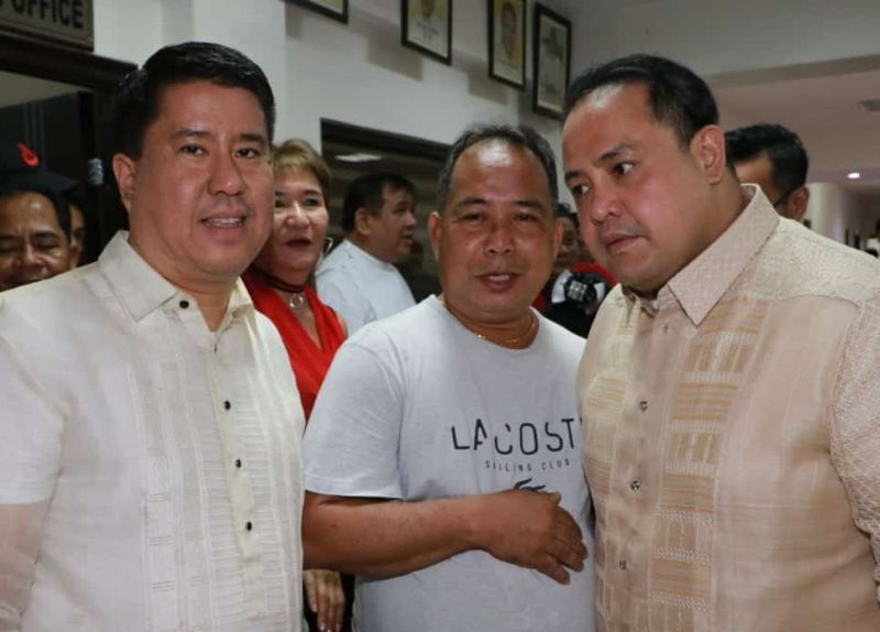 Former San Luis Mayor and Councilor Venancio Macapagal is flanked by Pampanga Gov. Dennis Pineda (R) and Fourth District Congressman Juan Pablo Bondoc during Sunday's oath taking of newly elected and reelected municipal officials of Candaba. Macapagal was reportedly endorsed by outgoing Speaker Gloria Macapagal Arroyo, Vice Gov. Lilia Pineda and her husband Rodolfo Pineda to be the next Pampanga Councilors League President. (Chris Navarro)