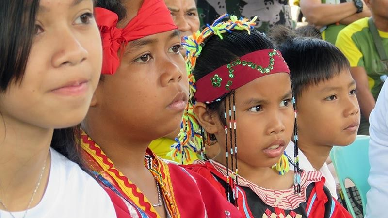 UNITED. Children of both indigenous tribe and settlers in rapt attention during the anniversary program of Peace 911. (Stella Estremera)