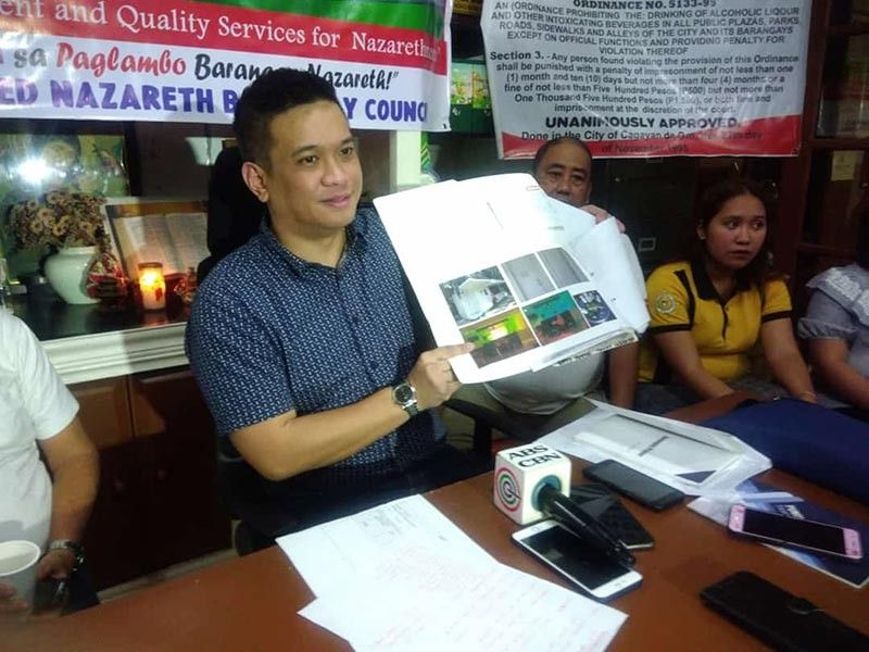 CAGAYAN DE ORO. Barangay Nazareth chairperson Maximo Rodriguez III shows to the media the proposed development plan once the contested tennis court will be demolished and converted into a multipurpose building. (Alwen Saliring)